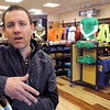 Ken Yuszkus/Staff photo: Swampscott:  Brett Reily, district manager, with the Greater Boston Running Company talks about the new Swampscott store which opened in September. He is at the Swampscott store.