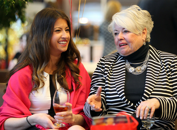 Samantha Bishop, left, and Marie Bishop, both of Peabody, chat during the 5th annual Gourmet Gala hosted at Acura of Peabody by the North Shore Medical Center to help raise money for the annual North Shore Cancer Walk/Run. DAVID LE/Staff photo