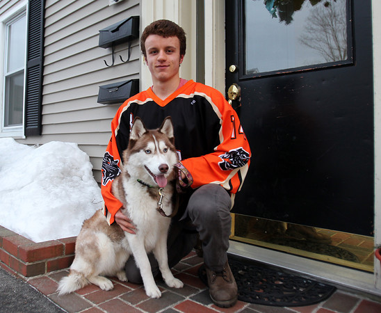 Beverly High School senior winger Jake Straw sits with his dog Luna outside his house on Friday afternoon. DAVID LE/Staff photo