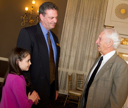 MARIA UMINSKI/SALEM NEWS BHS Hall of Fame inductee Bob Giunta and his eight year-old daughter Eva talk to Giunta's former headcoach Bill H amor before the induction ceremony at the Danversport Yacht Club on Saturday.