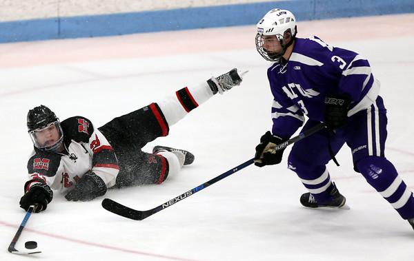 DAVID LE/Staff photo. Marblehead junior winger Braden Haley blows an edge but still reaches out to poke the puck past Boston Latin defenseman Alex Kibrick (3). 3/8/16.
