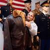 "KEN YUSZKUS/Staff photo.     Volunteer Amanda Nihan adjusts the flight jacket worn by pilot Clyde Hudnall at the ""World War II and the Greatest Generation"" display at the Peabody Historical Society.   03/08/16"
