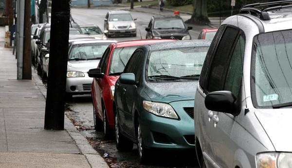KEN YUSZKUS/Staff photo.    Cars are parked along Lafayette Street south of Loring Avenue in Salem.     03/28/16