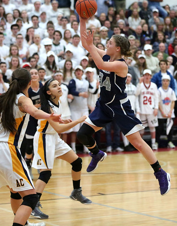 HADLEY GREEN/ Staff photo<br /> Hamilton-Wenham's Elizabeth Kirschner (34) shoots at the Hamilton-Wenham v. Arlington Catholic Division 2 North girls basketball championship finals at Wakefield High School on Saturday, March 10th, 2017.