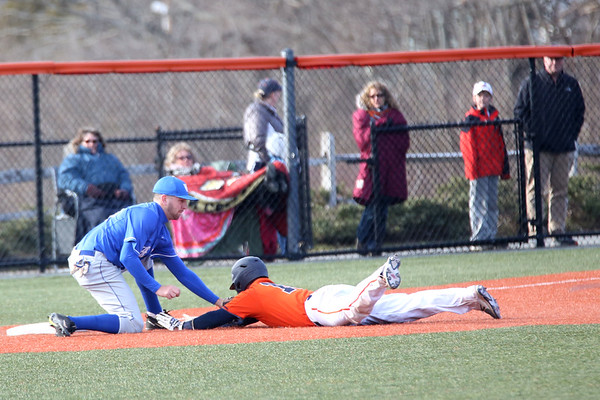 HADLEY GREEN/ Staff photo<br /> Salem State's Teghan Malionek (15) slides into third base before getting out during the Salem State v. Wheaton College men's varsity baseball at Salem State University on Thursday, March 30th, 2017.