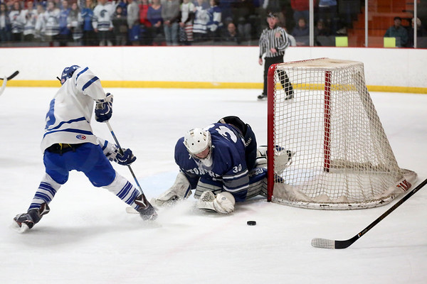 HADLEY GREEN/ Staff photo <br /> Danvers Conor Purtell (9) shoots while Stoneham's goalie Peter Barry (30) blocks the puck at the Danvers v. Stoneham boys hockey playoff game at the O'Brien rink in Woburn on Friday, March 3rd, 2017.