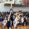 HADLEY GREEN/ Staff photo <br /> Marblehead's Patrick Bugler (4) shoots while Malden Catholic's Jonah St. Clair (34) tries to block him at the Marblehead vs. Malden Catholic Division 2 North quarterfinal playoff game at Marblehead High School on Saturday, March 4th, 2017.