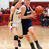 HADLEY GREEN/ Staff photo<br /> Hamilton-Wenham's Catherine Blatchford (31) dribbles towards the basket while Arlington Catholic's Erin Donlan (5) guards her at the Hamilton-Wenham v. Arlington Catholic 	Division 2 North girls basketball championship finals at Wakefield High School on Saturday, March 10th, 2017.