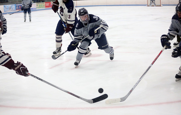 HADLEY GREEN/ Staff photo <br /> St. John's Ryan Farrow (15) skates towards the puck during the St. John's Prep v. Belmont High Division 1 North MIAA playoff game at the Chelmsford Forum on Wednesday, March 1st, 2017.