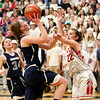 HADLEY GREEN/ Staff photo <br /> Hamilton-Wenham's Cate Blatchford (31) shoots while Wakefield's Hailey Lovell (22) guards her during the Hamilton-Wenham v. Wakefield Division 2 North quarterfinal girls basketball game at Woburn High School on Wednesday, March 8th, 2017.