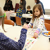HADLEY GREEN/ Staff photo <br /> Sydney Costanzo, 5, plays bingo during the Dr. Seuss birthday party at the Peabody Institution Library South Branch on Thursday, March 2nd, 2017.