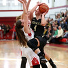 HADLEY GREEN/ Staff photo<br /> Bishop Fenwick's Olivia DiPietro (4) drives to the basket while Amesbury's Flannery O'Connor (12) and Kimberly Croce (3) play defense at the Bishop Fenwick v. Amesbury Division 3 girls basketball championship game at Wakefield High School on Saturday, March 10th, 2017.