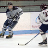 HADLEY GREEN/ Staff photo <br /> St. John's K.J. Sarni (21) moves the puck while Belmont's Adam Cronin (22) plays defense during the St. John's Prep v. Belmont High Division 1 North MIAA playoff game at the Chelmsford Forum on Wednesday, March 1st, 2017.