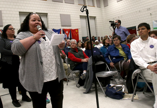 HADLEY GREEN/ Staff photo<br /> Lucy Corchado of Salem speaks about why she hopes the Sanctuary for Peace ordinance is passed at a public hearing held at the Bentley School on Wednesday night.