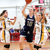 HADLEY GREEN/ Staff photo<br /> Hamilton-Wenham's Kelly Walsh (10) shoots while Arlington Catholic players defend her at the Hamilton-Wenham v. Arlington Catholic Division 2 North girls basketball championship finals at Wakefield High School on Saturday, March 10th, 2017.
