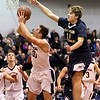 HADLEY GREEN/ Staff photo <br /> Marblehead's Bo Millett (0) shoots while Malden Catholic's Cameron Kelly (11) defends him at the Marblehead vs. Malden Catholic Division 2 North quarterfinal playoff game at Marblehead High School on Saturday, March 4th, 2017.