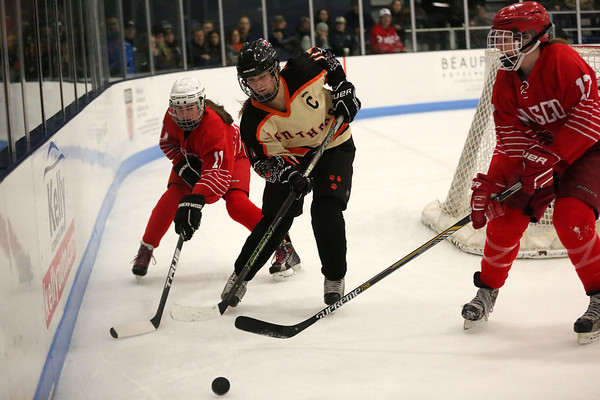 HADLEY GREEN/ Staff photo <br /> Beverly's Marlee Hamor (11) goes after the puck while Masco's Anna Behringer (11) and Rachael Duval (17) play defense at the Beverly v. Masco girls hockey game at the Bourque Arena in Beverly on Friday, March 3rd, 2017.