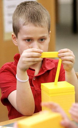 KEN YUSZKUS / Photo.   Caleb Shelby, 2nd grade student, builds his project while in Maker Space at the school library. Students are working on new technology projects at Cove Elementary School in Beverly.   3/2/17