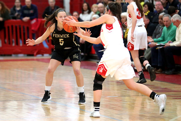 HADLEY GREEN/ Staff photo<br /> Bishop Fenwick's Samantha Gallant (5) plays defense while Amesbury's Madison Napoli (1) dribbles down the court at the Bishop Fenwick v. Amesbury Division 3 girls basketball championship game at Wakefield High School on Saturday, March 10th, 2017.