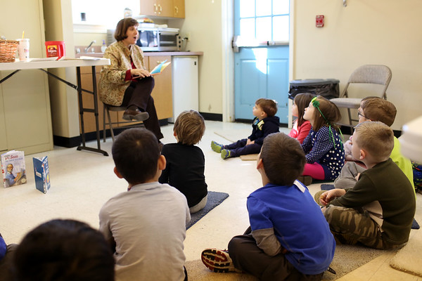 HADLEY GREEN/ Staff photo <br /> Children's librarian Betsy Reid reads a Dr. Seuss book to children at the Dr. Seuss birthday party at the Peabody Institution Library South Branch on Thursday, March 2nd, 2017.