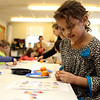 HADLEY GREEN/ Staff photo <br /> Zoe Falasca, 6, plays bingo during the Dr. Seuss birthday party at the Peabody Institution Library South Branch on Thursday, March 2nd, 2017.