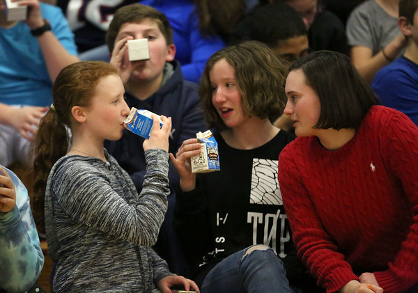 HADLEY GREEN/ Staff photo <br /> From left to right, Sixth graders Selia Rocheville, Griffin L'Italien, Brooke Ryan and Molly Mercier talk while drinking cartons of milk at the 'March Moo-ves' kick off event at Collins Middle School in Salem on Tuesday, March 7th, 2017. The event was sponsored by the New England Dairy & Food Council, and aimed to raise awareness about Dairy is Local Month.