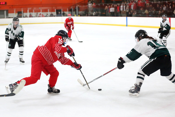 HADLEY GREEN/ Staff photo <br /> Masco's Abby Gendron (16) and Austin Prep's Shannon Burke (15) vie for the puck at the Masco v. Austin Prep girls hockey state playoff game at the O'Brien rink in Woburn on Tuesday, March 7th, 2017.