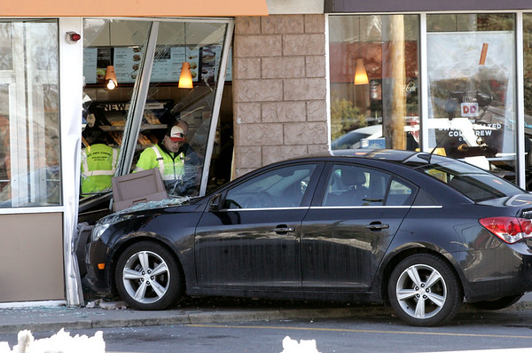 vehicle crashed into Dunkin' Donuts building