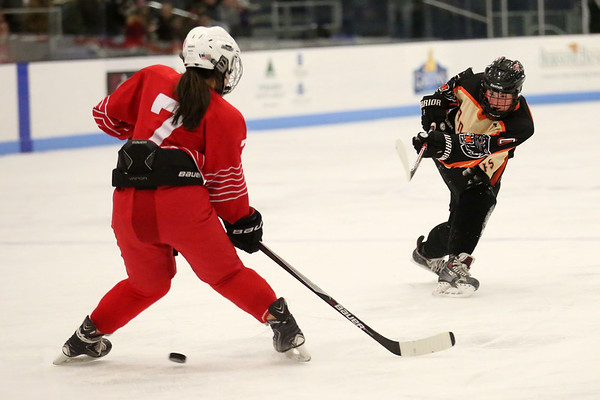 HADLEY GREEN/ Staff photo <br /> Beverly's Brittany Foster (20) shoots while Masco's Isabelle Sarra (7) plays defense at the Beverly v. Masco girls hockey game at the Bourque Arena in Beverly on Friday, March 3rd, 2017.