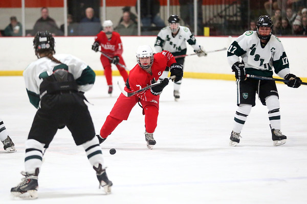 HADLEY GREEN/ Staff photo <br /> Masco's Izzy Sarra (7) moves the puck towards the goal while Austin Prep's Maddie Rinklin (18) and Caroline Benson (17) play defense at the Masco v. Austin Prep girls hockey state playoff game at the O'Brien rink in Woburn on Tuesday, March 7th, 2017.