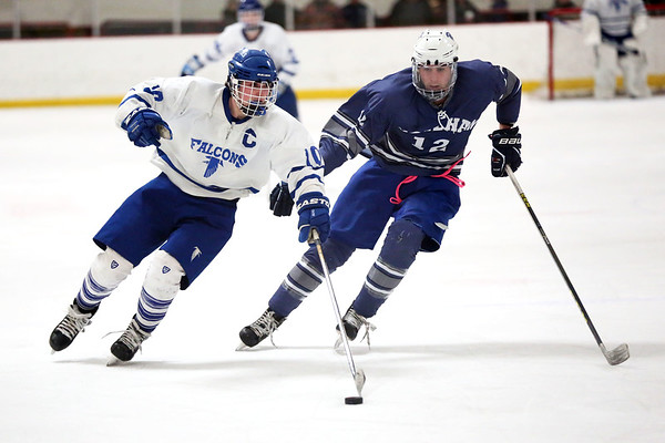 HADLEY GREEN/ Staff photo <br /> Danvers' Robert Tibbetts (10) and Stoneham's Adrian Sousa (12) skate towards the puck at the Danvers v. Stoneham boys hockey playoff game at the O'Brien rink in Woburn on Friday, March 3rd, 2017.