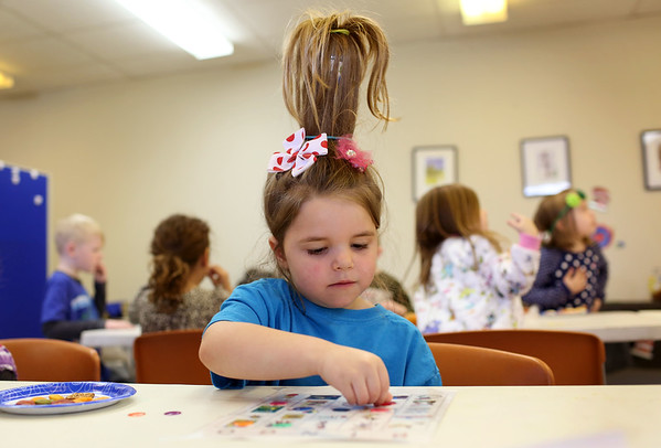 HADLEY GREEN/ Staff photo <br /> Colbie Gilbert of Peabody did her hair like Dr. Seuss' character, Cindy Lou Who, for the Dr. Seuss birthday party at the Peabody Institution Library South Branch on Thursday, March 2nd, 2017.