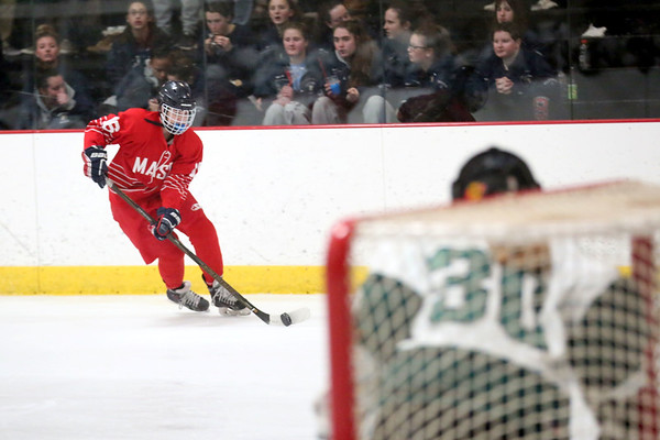 HADLEY GREEN/ Staff photo <br /> Masco's Abby Gendron (16) prepares to shoot while Austin Prep's goalie Hannah Aveni (30) defends during first quarter action of the Masco v. Austin Prep girls hockey state playoff game at the O'Brien rink in Woburn on Tuesday, March 7th, 2017.