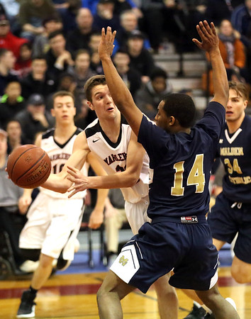HADLEY GREEN/ Staff photo <br /> Marblehead's Derek Marino (23) looks for an open pass while Malden Catholic's Michael Boyd (14) guards him at the Marblehead vs. Malden Catholic Division 2 North quarterfinal playoff game at Marblehead High School on Saturday, March 4th, 2017.