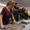Kim Ayers, of Salem, and, Christina Capra, 16, also of Salem, sort through clothes donations made for those affected by the Dow St. fire which displaced 45 people. DAVID LE/Staff photo. 5/10/14
