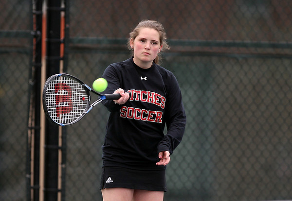 Salem junior Ari Gaffney keeps her eyes on the ball while playing against Swampscott in first singles play on Tuesday afternoon. DAVID LE/Staff photo. 5/13/14.