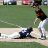 KEN YUSZKUS/Staff photo. Peabody's Ryan Collins gets back on 1st as Beverly's Kevin Cuneo gets the ball from pitcher Dave Drinkwater during the Peabody at Beverly baseball game for the Northeastern Conference North title.      5/19/14