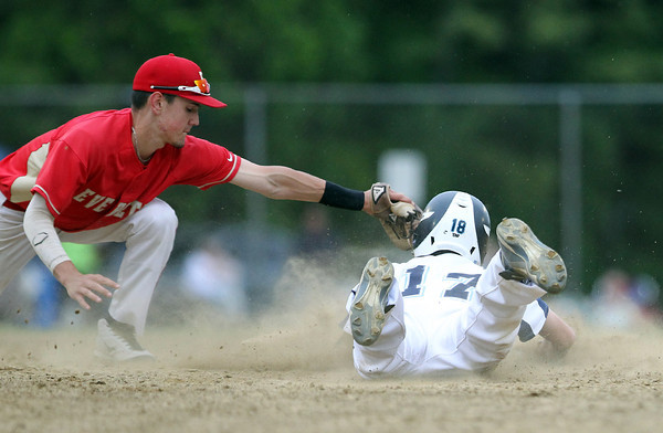 Peabody center fielder Matt Gonick (17) slides safely headfirst into second base before the tag from the Everett shortstop. DAVID LE/Staff photo. 5/26/14.