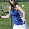 KEN YUSZKUS/Staff photo. Danvers singles player Shannon Vellieux is ready to return the ball during the Peabody at Danvers girls tennis match.       5/5/14