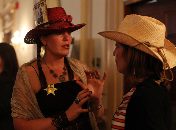 Rebecca Rohloff, Professor of Art Education at Salem State University, left, talks with Mary Tuttle, Teacher at the Bentley School in Salem, at the 20th Annual Hats Off to Education Fundraiser at the Hawthorne Hotel on Friday. DAVID LE/Staff photo. 5/9/14.
