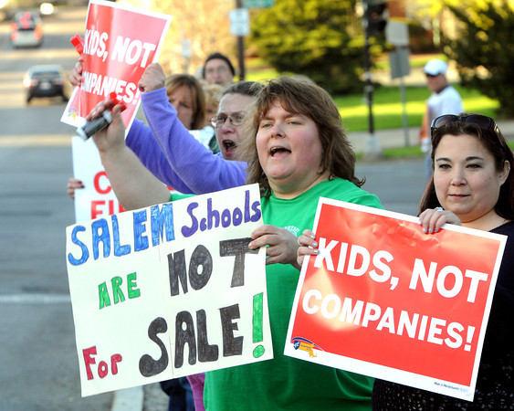 KEN YUSZKUS/Staff photo.  From left, Lee Ann O'Neil of Bates School, jill Girard, and Rebecca Walsh, both of Bentley School, demonstrate outside the Salem School Committee meeting, where a vote will be taken on whether to turn over management of Bentley School to a private non-profit firm.   5/5/14