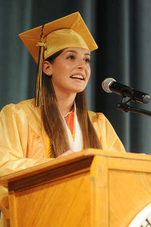 STAFF KEN YUSZKUS.  Senior class president Arianna Maida gives the welcome address at the Bishop Fenwick graduation.
