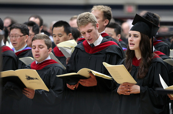 """Gordon-Conwell graduates from left, David Elston, Peter Frey, and Amy Gannett sing along to """"Guide Me, O Thou Great Jehovah"""" during Commencement on Saturday morning. DAVID LE/Staff photo. 5/10/14"""