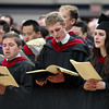 "Gordon-Conwell graduates from left, David Elston, Peter Frey, and Amy Gannett sing along to ""Guide Me, O Thou Great Jehovah"" during Commencement on Saturday morning. DAVID LE/Staff photo. 5/10/14"