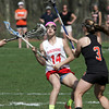 KEN YUSZKUS/Staff photo.  Masco's Sammy Dindo stops short with Ipswich's Claire Gardner stopping her progress during the Ipswich at Masconomet girls lacrosse game. 5/12/14