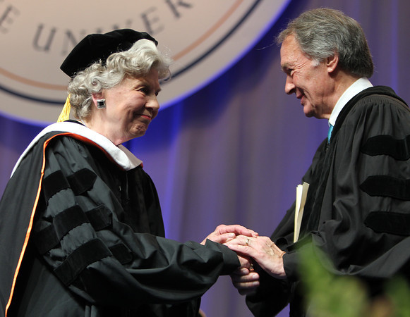 Joanne Holbrook Patton, left, gets a warm handshake from Senator Ed Markey, right, after she was named as an Honorary Degree Recipient on Saturday afternoon during the Salem State University Commencement ceremonies. DAVID LE/Staff photo. 5/18/14.