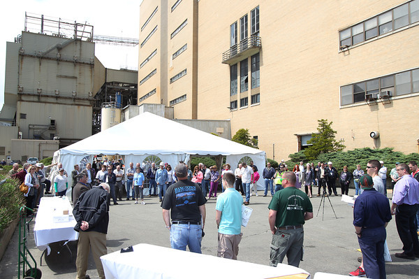 Past and present workers at the Salem Power Plant gather around for some remarks from Footprint's Peter Furniss and Scott Silverstein, during a final worker barbecue on Thursday afternoon. David Le/Staff Photo. 5/16/14.