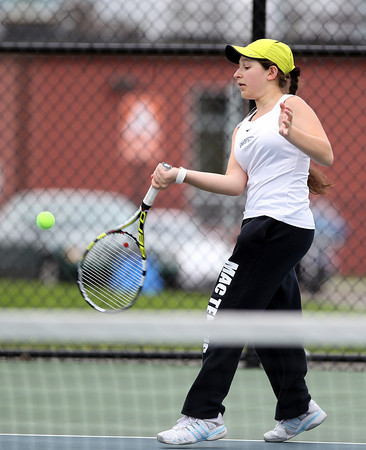 Swampscott junior Anna Raptunovich returns a volley against Salem in first singles play on Tuesday afternoon. DAVID LE/Staff photo. 5/13/14.
