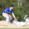 Pingree freshman Cameron Schmitt (18) slides safely into third base before Lexington Christian Academy third baseman Thomas Segreve can apply the tag. Schmitt tripled in two runs in the 1st inning. DAVID LE/Staff photo. 5/14/14.