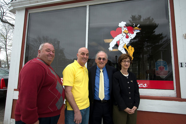 JIM VAIKNORAS/Staff photo Hago Harrington, Ken Rothwell, Brendan Walsh, and Linda Saris poses on North st in Salem. Walsh is passing control of the Giving Tree Award to Rothwell, Harrington and Saris are former winners of the award.